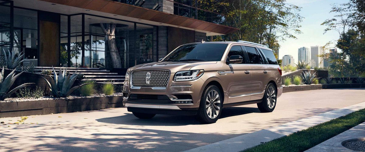 Brown 2018 Lincoln Navigator parked outside of a building on a sunny day